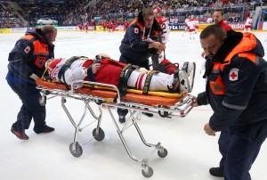 MOSCOW, RUSSIA. MAY 10, 2016. Denmark's Jesper B. Jensen receives medical aid in the 2016 IIHF World Championship Preliminary Round Group A ice hockey match against Switzerland at VTB Ice Palace. Team Switzerland won the game 3:2 in extra time. Artyom Korotayev/TASS (Photo by Artyom Korotayev\TASS via Getty Images) MOSCOW, RUSSIA. MAY 10, 2016. Denmark's Jesper B. Jensen receives medical aid in the 2016 IIHF World Championship Preliminary Round Group A ice hockey match against Switzerland at VTB Ice Palace. Team Switzerland won the game 3:2 in extra time. Artyom Korotayev/TASS (Photo by Artyom Korotayev\TASS via Getty Images)