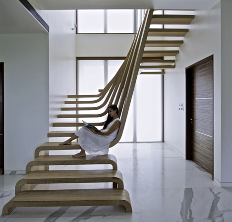 curved-waterfall-wooden-staircase