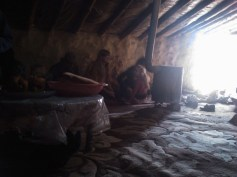 Drinking tea inside one of the huts.