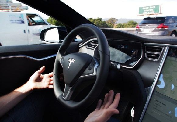 Demonstrating Tesla's new Auto Steer and Land Change features
