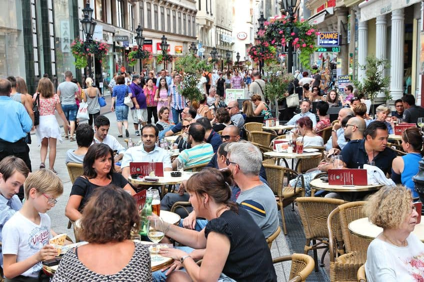 39860922 - budapest, hungary - june 19, 2014: people visit vaci street in budapest. 3.3 million people live in budapest metropolitan area. it is the largest city in hungary and 9th largest in the eu.