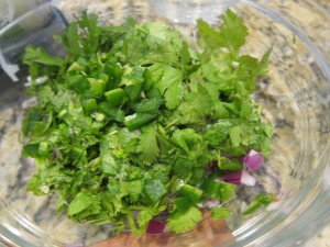 Cilantro from the garden over chopped red onions just waiting for the avocado for homemade guac.
