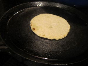 Cooking up the tortillas.  Helps to have a tortilla warmer on the side to keep the tortillas warm as you go.