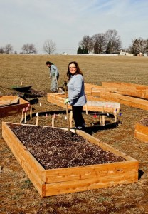 The author (Jane Jensen) helping to install a new kitchen garden on the farm.