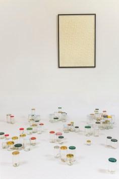 Gianluca Quaglia, Paesaggio, 2014, intagli su carta, 320 barattoli di vetro, misure ambientali Foto Marcella Savino