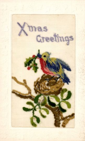 Postcards from the Front: Britain 1914-1919 - a multi-coloured bird carrying a sprig of holly (or mistletoe?)