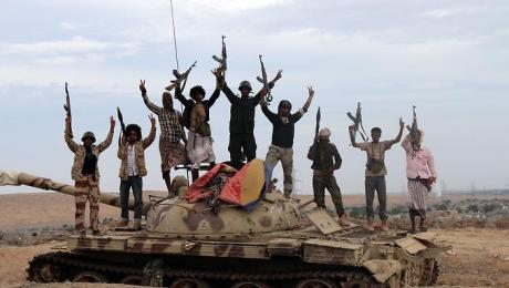 epa04676405 Tribal militiamen loyal to Yemeni President Abdo Rabbo Mansour Hadi stand on a tank positioned in the southern city of Lahj, Yemen, 23 March 2015. Reports state that tribal militiamen loyal to Yemeni President Hadi are deployed around the city of Lahj, along the border with Taiz city which was captured one day ago by Shiite Houthi rebels. Houthi leader Abdul-Malik al-Houthi has called on his supporters to mobilise towards the south of Yemen. EPA/STR  EPA/STR