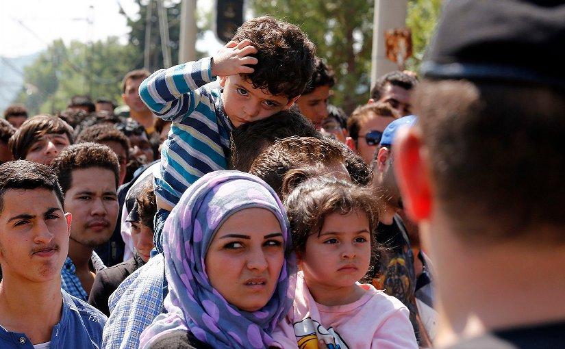 Refugees wait to cross the Greek-Macedonia border, 24 August 2015. Photo Credit: Bundesministerium für Europa, Integration und Äusseres, Wikipedia Commons.