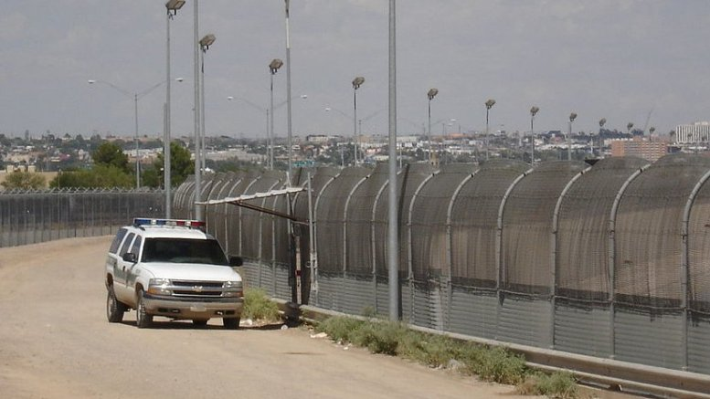 The U.S. border fence near El Paso, Texas. Photo Credit: Office of Representative Phil Gingrey, Wikipedia Commons.