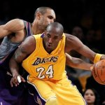 Kobe Bryant dribbles around Grant Hill in Game 1 of the 2010 NBA Western Conf. Finals