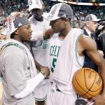 Celtics guards Nate Robinson (L) and Rajan Rondo (R) congradulate each other as center Kevin Garnett looks on