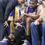 Lakers trainer Gary Vitti speaks to Andrew Bynum about his knee in game 3 of the 2010 NBA Finals