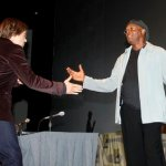 "Samuel L.  Jackson, right, welcomes Robert Downey Jr. onto the stage during a panel  for the movie ""The First Avenger"" at Comic-Con International Saturday, July 24, 2010 in San Diego."