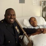 NYPD Sergeant Grevirlene Kersellius holding the hand of her hero, Officer James Atkins (Photo by James Keivom)