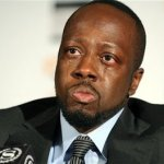 Wyclef Jean is overcome with emotion while discussing the earthquake ravaged cities and defending Yele Haiti&#039;s relief efforts, Monday, Jan. 18, 2010, in New York.