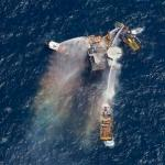 Boats spray water on platform that exploded in the Gulf of Mexico on 09-02-10