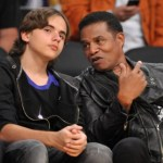 Jackie Jackson and Prince Michael I at a Los Angeles Lakers game.