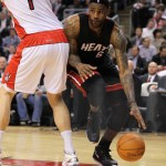 LeBron James #6 of the Miami Heat plays around Andrea Bargnani #7 of the Toronto Raptors in a game on Feb. 16, 2011 at the Air Canada Centre in Toronto, Canada. The Heat defeated the Raptors 103-95.
