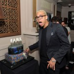 "Chris Brown blows out the candles at his ""F.A.M.E."" album release dinner at Abe & Arthur's on March 22, 2011 in New York City."