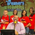 Steve Harvey poses for photo with Disney Academy students during a break in his radio show broadcast at Disney's BoardWalk Resort in Lake Buena Vista, Fla.