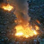 Buildings burn following an 8.9 earthquake in Yamada, Japan on March 11, 2011