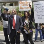 Najee Ali and protestors outside home of Marilyn Davenpoprt