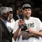 Dirk Nowitzki #41 of the Dallas Mavericks holds up the Bill Russell Finals MVP trophy after Bill Russell presented it to him following the Mavericks 105-95 win against the Miami Heat in Game Six of the 2011 NBA Finals at American Airlines Arena on June 12, 2011 in Miami.
