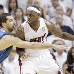 Dallas' Peja Stojakovic and Miami's LeBron James