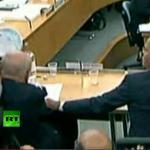 Rupert Murdoch almost gets an old fashioned pie in the face during Parliament proceedings over media scandal at News Corp.