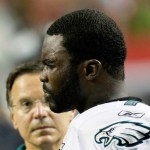 Michael Vick #7 of the Philadelphia Eagles stands on the sidelines after being injured in the third quarter against the Atlanta Falcons at Georgia Dome on Sept. 18, 2011 in Atlanta