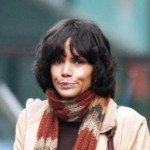Halle Berry braces herself against the harsh Scottish weather hugging a hot water bottle for warmth and wearing a thick padded coat on the set of &quot;Cloud Atlas,&quot; a new film shooting in Glasgow made to resemble San Francisco.