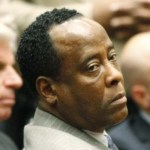 Dr. Conrad Murray remains expressionless next to his attorney J. Michael Flanagan (L) after the jury returned with a guilty verdict in his involuntary manslaughter trial in Los Angeles November 7, 2011. Murray was found guilty on Monday of involuntary manslaughter in the pop star's death. REUTERS/Al Seib/Pool  (UNITED STATES - Tags: CRIME LAW ENTERTAINMENT)
