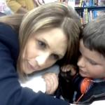 Michele Bachmann asks Elijah to repeat himself at her book signing, not knowing that it would be a remark defending his gay mother.