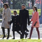 President Barack Obama, first lady Michelle Obama (L) and daughters Malia Obama (R) and Sasha Obama (2L) walk from the White House across Lafayette Park to St. John's Church for Sunday services Dec. 11, 2011 in Washington, DC