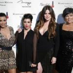 Television personalities Kim Kardashian, Kourtney Kardashian, Khloe Kardashian and Kris Jenner arrive at the grand opening of the Kardashian Khaos store in Las Vegas