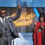 Vashawn Mitchell receives 'Artist of the Year' trophy from Cece Winans at theh Annual Stellar Awards. (Photo credit: Rick Diamond / Courtesy of Central City Productions & The FrontPage Firm)