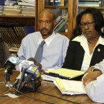 Attorney Caree Harper (center) with the family of Kendrec McDade