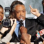 Rev. Al Sharpton (C) speaks at a rally with Tracy Martin (R), and Sybrina Fulton (L), parents of slain teenager Trayvon Martin, on March 22, 2012 in Sanford, Florida