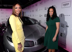 Shawn Johnson and Michelle Ebanks pose with 2013 Lincoln MKS