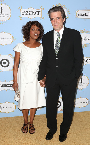 Actress Alfre Woodard (L) and her guest attend the Sixth Annual ESSENCE Black Women In Hollywood Awards Luncheon at the Beverly Hills Hotel on February 21, 2013 in Beverly Hills