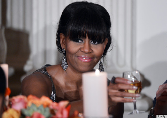 irst Lady Michelle Obama makes a toast during the 2013 Governor's Dinner in the State Dinning Room of the White House in Washington, DC, on February 24, 2013