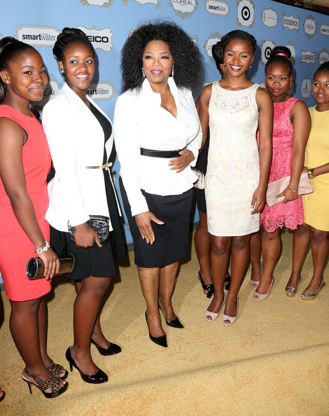 Oprah Winfrey (C) and students from her school in Africa attend the Sixth Annual ESSENCE Black Women In Hollywood Awards Luncheon at the Beverly Hills Hotel on February 21, 2013 in Beverly Hills