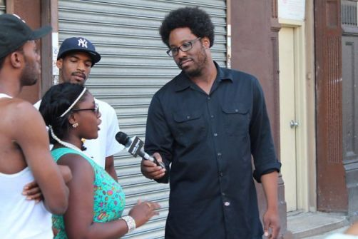 W. Kamau Bell (right) interviews residents of Harlem about New York's &quot;stop and frisk&quot; law on the premiere of his topical weekly show on FX, &quot;Totally Biased With W. Kamau Bell.&quot; 