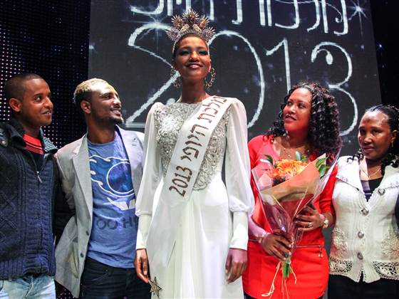 Yityish Aynaw stands with friends after being crowned Miss Israel on Feb. 27.