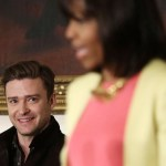 first lady Michelle Obama speaks as musicians (L-R) Justin Timberlake, Charlie Musselwhite, and Ben Harper listen during an interactive student workshop at the State Dining Room of the White House April 9, 2013 in Washington, DC