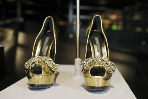 "In this Thursday, July 17, 2014 photo, the shoes from Beyonce's ""Sweet Dreams"" are displayed in a new exhibit at the Rock and Roll Hall of Fame in Cleveland."