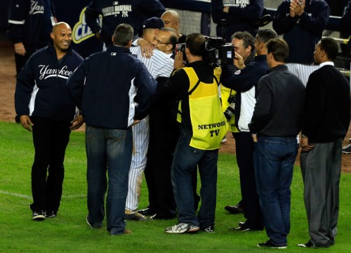 Derek Jeter #2 of the New York Yankees celebrates with Joe Torre following a walk-off victory against the Baltimore Orioles during a game at Yankee Stadium on September 25, 2014 in the Bronx borough of New York City