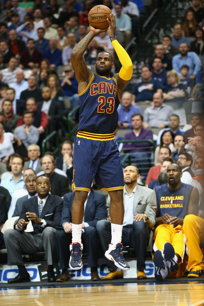 LeBron James #23 of the Cleveland Cavaliers takes a shot against the Dallas Mavericks at American Airlines Center on March 10, 2015 in Dallas, Texas