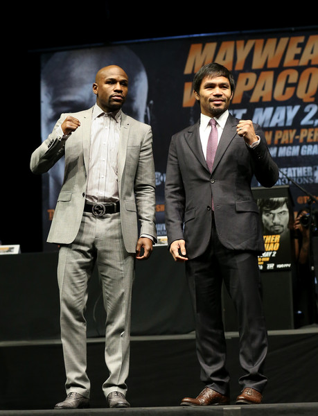 Floyd Mayweather (L) and Manny Pacquiao pose together at the end of their Press Conference promoting their upcoming fight on March 11, 2015 in Los Angeles, California