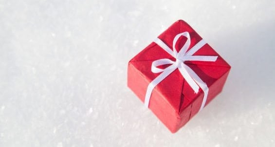 small christmas gift box on white snow background